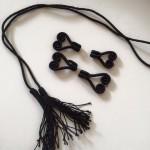 zwarte riemhaakjes