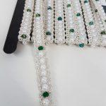 Parelband met groene steentjes